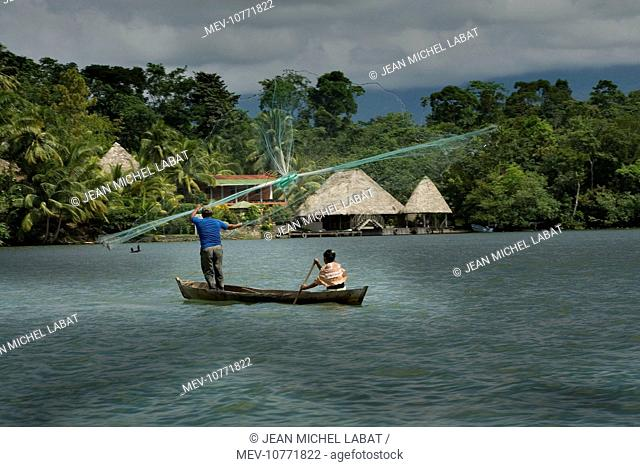 People fishing - casting nets. Dulce River - Guatemala