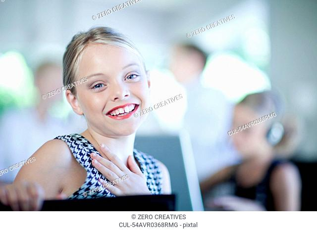 Girl playing businesswoman in chair