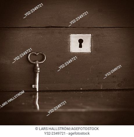 Closeup of closed vintage wooden chest and key
