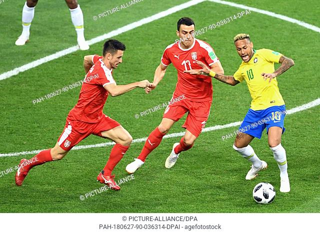 27 June 2018, Russia, Moscow: Soccer, World Cup, Serbia vs Brazil, group E, at the Spartak-Stadium. Brazil's Neymar (r-l) and Serbia's Filip Kostic and Antonio...