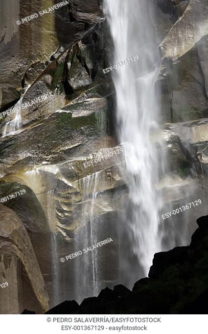 detail of the waterfall known as vernal fall falling on a smooth wall of granite in Yosemite National Park, USA