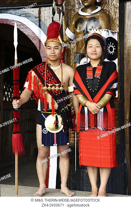 Couple of Naga tribal people in traditional clothing, Kisima Nagaland Hornbill festival, Kohima, Nagaland, India