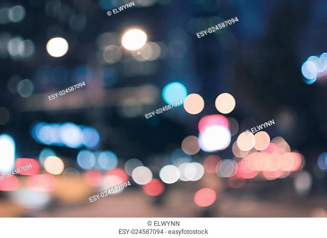 Abstract urban background with blurred buildings and street, shallow depth of focus
