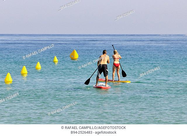 Couple. Surf kayaking, sport that comes from a cross between the worlds of kayaking and surfing. It is to use the driving force of the waves to slide over them...