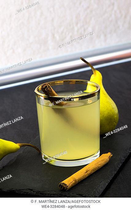 Pear cocktail with cinnamon stick