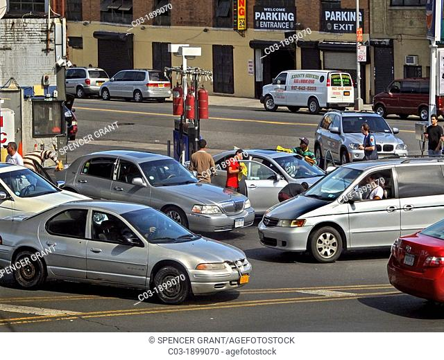 Cars crowd a gas station and car wash in the Bronx, New York City