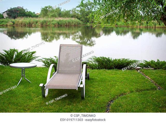 Sun lounger on the lake