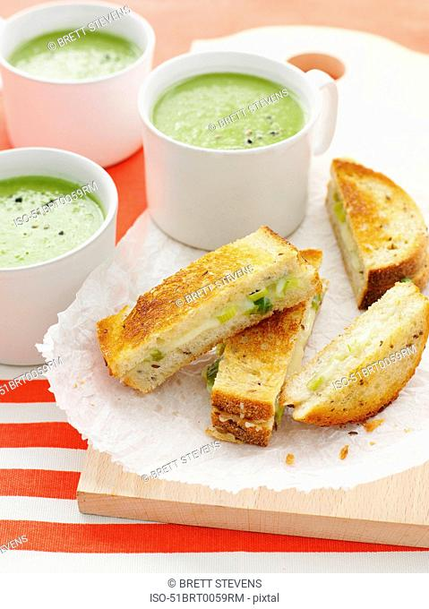 Plate of grilled sandwiches with soup