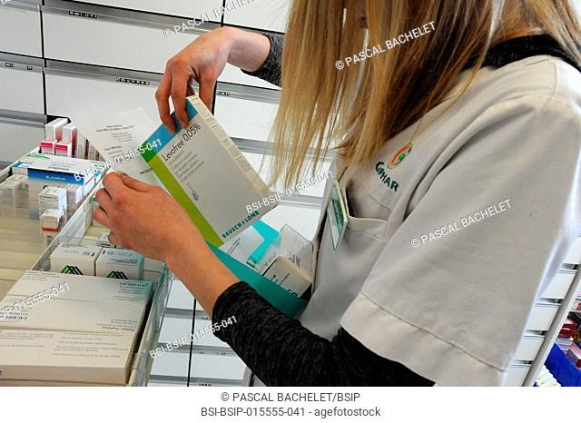 Reportage in a pharmacy in Auxi-le-Château, France. Trainee pharmacy technician