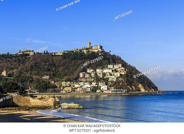San Sebastian, Spain - Jan 2019: Pico Del Loro (Parrot's Beak) and in the distance houses and apartments on Igeldo mountain range