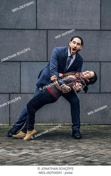 Businessman holding woman outdoors