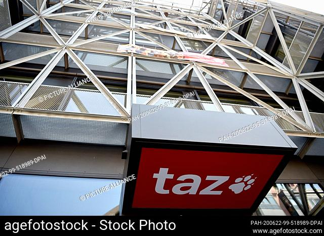 """22 June 2020, Berlin: The logo of the daily newspaper """"""""taz"""""""" can be seen at the entrance of the editorial building in Berlin-Mitte"""