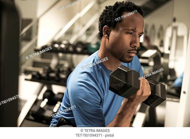 Mid adult man working out in gym