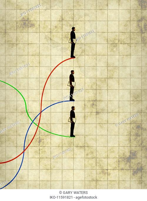 Businessman on three different line graphs