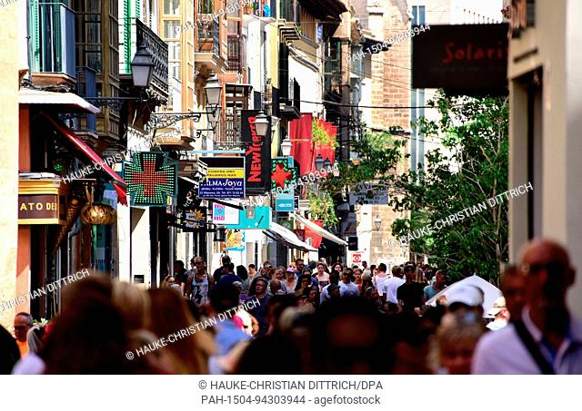 People in the shopping street Carrer de Sant Miquel in the city center of Palma de Mallorca (Spain), 22 July 2017. | usage worldwide