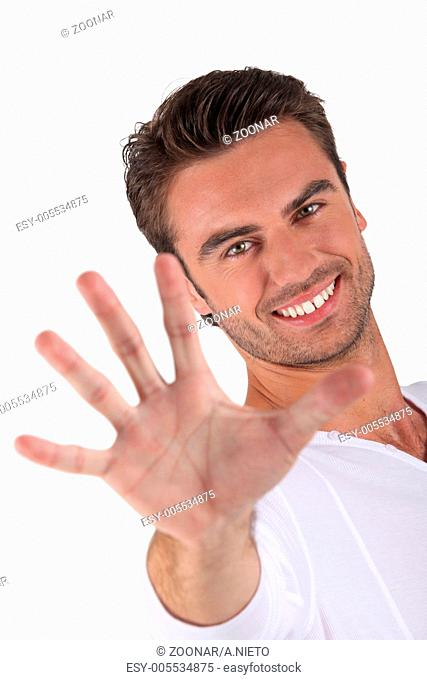 Young man holding out hand