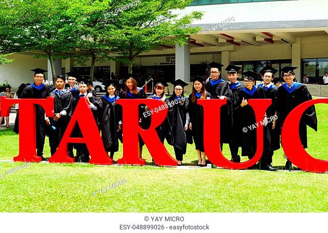 Setapak, Kuala Lumpur, Malaysia. August 27, 2017:Beautiful young graduates with diplomas standing in front of Tunku Abdul Rahman Universiti College (TARUC)