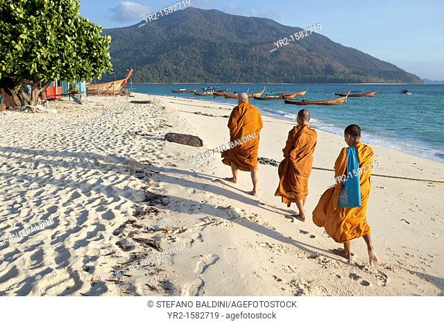 Monks collecting morning alms on the island of Ko Lipe, Thailand