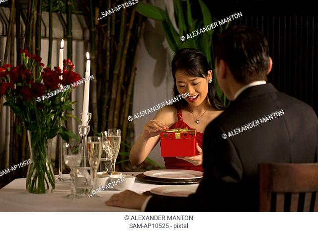 Singapore, Woman holding gift in restaurant