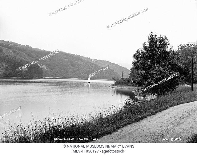 Glenasmole Lower Lake - a view of a lake with a boat sailing. (Location: Republic of Ireland; County Dublin; Glenasmole)