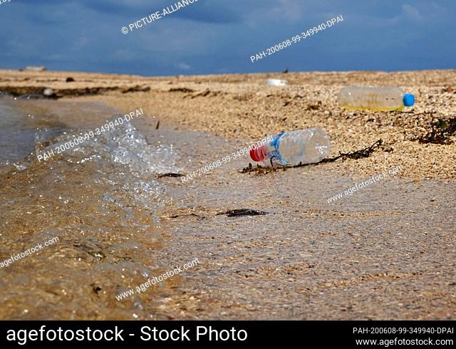 27 October 2019, Thailand, Ko Mak: Empty plastic water bottles lie on the beach. The island is about 16 square kilometers and is located in the eastern Gulf of...