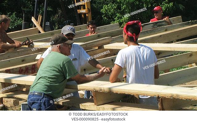 Crew discussing barn planning