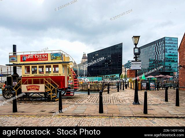 Liverpool, United Kingdom - April 26, 2019: A beautiful classic ice-cream van at the Liverpool Docks, Port of Liverpool, late on a cloudy afternoon