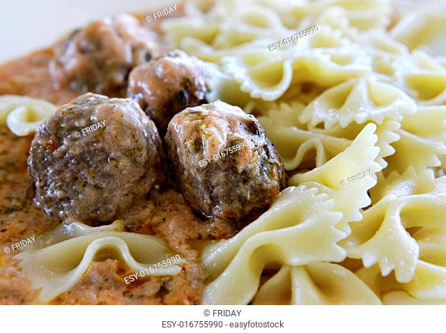 Small buckwheat cakes with pasta and sauce