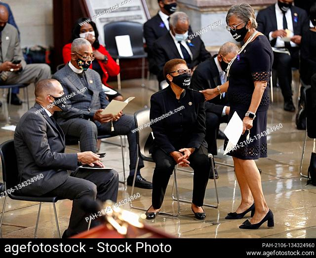 Chair of the Congressional Black Caucus, United States Representative Karen Bass (Democrat of California) (seated, C) prior to the start of the ceremony...