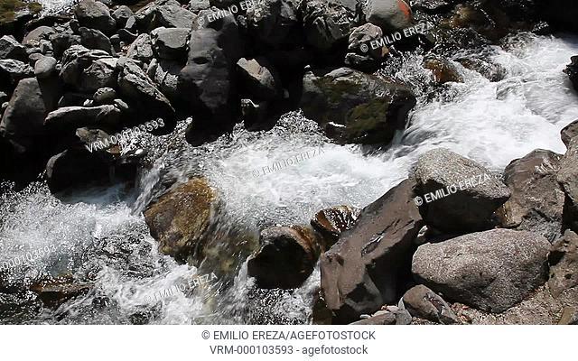 River and waterfall. Eths Uelhs deth Jueu. Valle de Aran. Catalonia, Spain