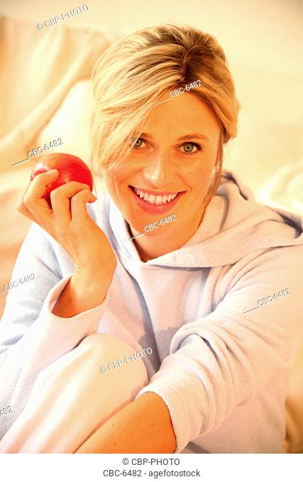 Portrait of Young Woman Eating an Apple