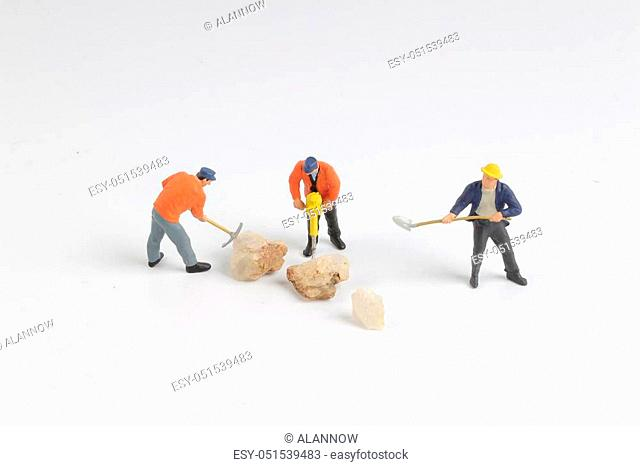 the Figurine of construction worker at construction site