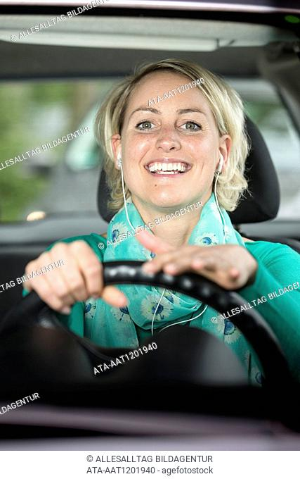 Female car driver is singing in the car