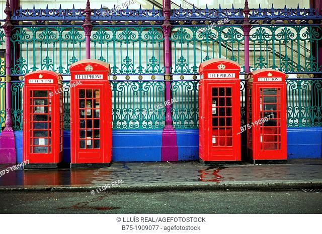 Red telephone box in Smithfield Market in Farringdon, London, England, UK, meat market