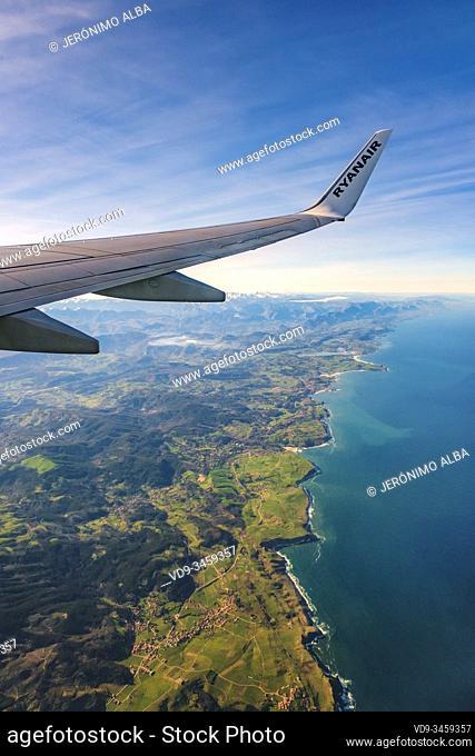 Plane flying over sea coast of Cantabria, Cantabrian Sea. North Spain. Europe