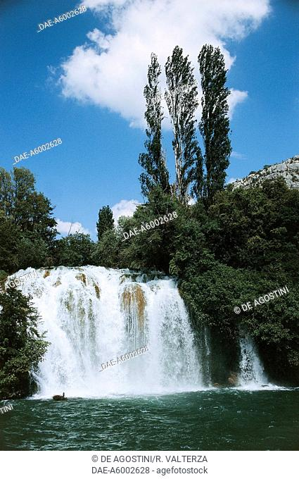 The Krka River at the Roski Slap Waterfalls, consisting of the main falls (22.5 metres high and 450 metres wide) and the lower falls known as The Necklaces