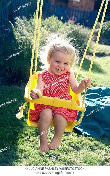2 year old girl swinging