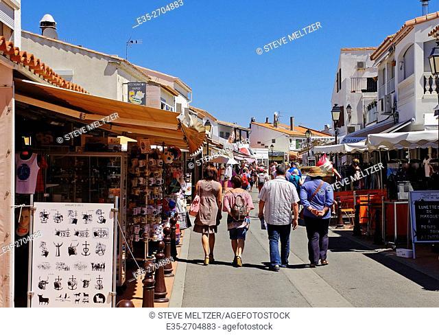Tourists stroll through the shops in the center of les Saintes-Marie de la mer