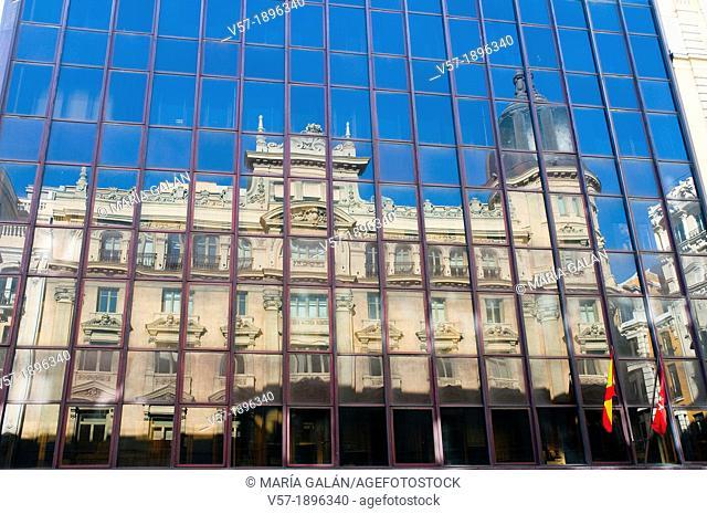 Building reflected on glass facade. Gran Via, Madrid, Spain