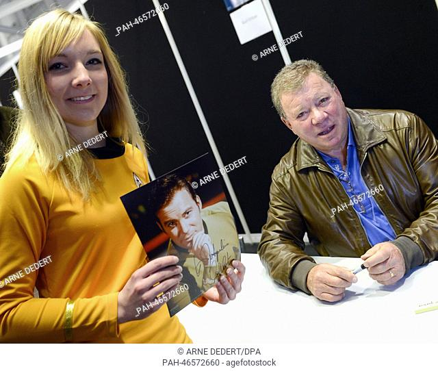 Star Trek fan Jacqueline Jardine receives an autograph from William Shatner who played James T. Kirk in the tlevision series Star Trek during a Star Trek...