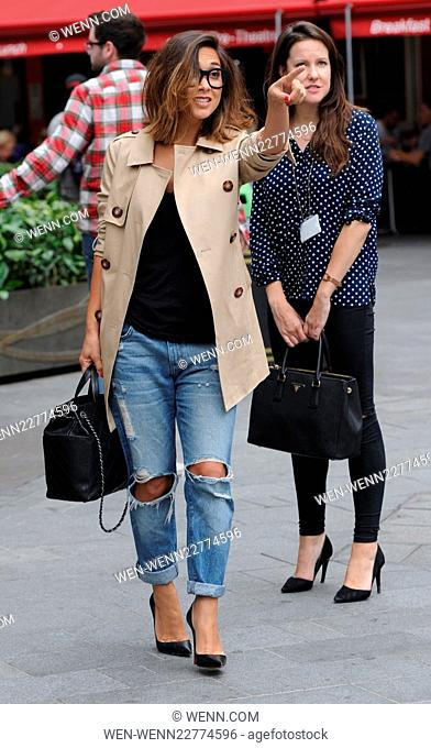Myleene Klass leaving Global House with her daughter Ava. They both stop to watch a bubble performer in London Featuring: Myleene Klass Where: London