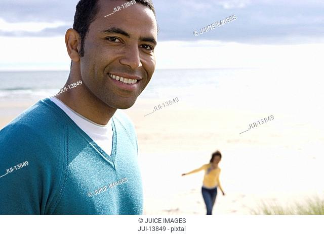 Portrait of man on beach smiling, close-up
