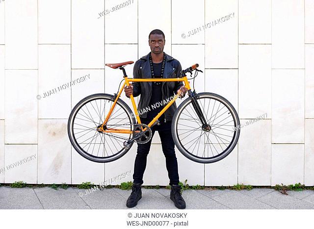 Man holding his bike