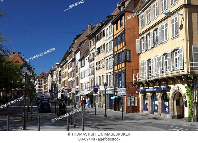 A street of houses in the old part of town of Strasbourg with the facades of historical buildings, France