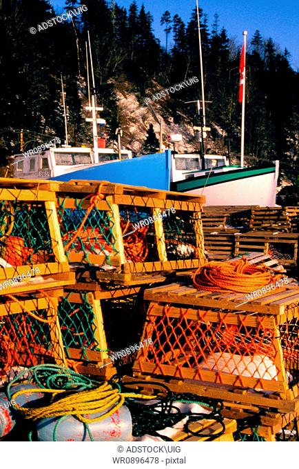 A stack of lobster traps sit on the dock awaiting the start of the fishing season, taken in Satin Martins New Brunswick Canada
