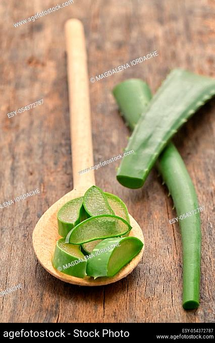 Aloe Vera Slices On Wooden Table And Spoon