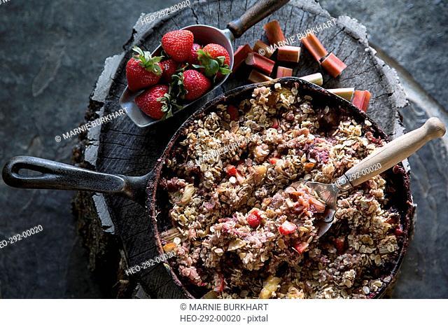 Still life fresh skillet strawberry granola