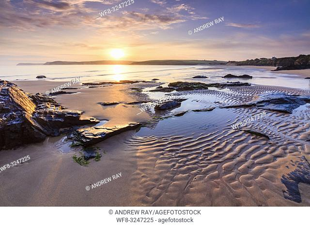 The first light of the day on Harlyn Beach, near Padstow on the North coast of Cornwall