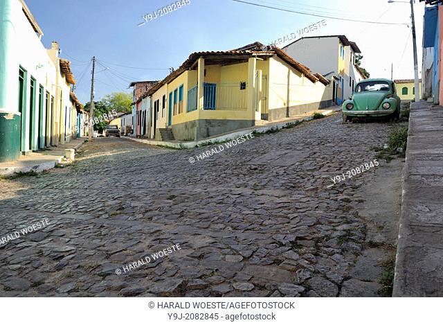 Brazil, Bahia, Lencois (Parque Nacional de Chapada Diamantina): Old historic Volkswagen Beetle parked in one of Lencois' cobblestone roads