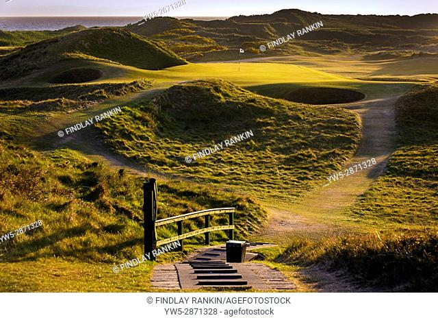 Sunset over the iconic putting green at 8th, Troon, Ayrshire, Postage Stamp, Royal Troon Golf Course, Scotland